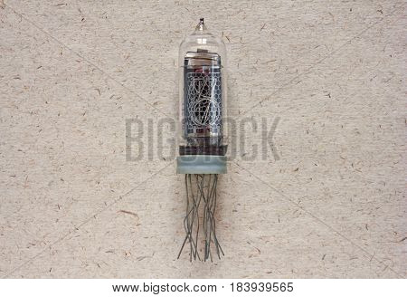 Close-up view of vintage nixie tube indicator of the numbers on craft paper background