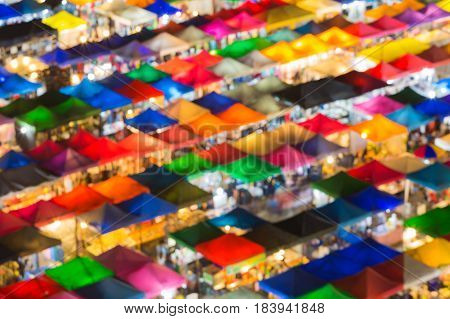 Blurred bokeh light night market roof top abstract background