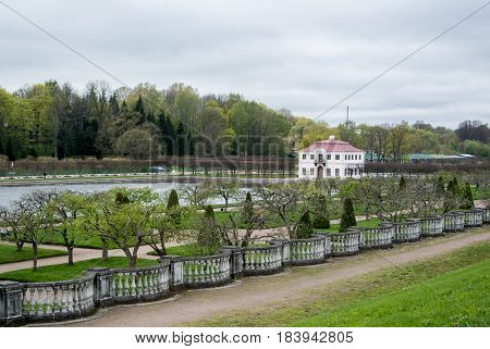 PETERHOF RUSSIA - MAY 10 2015: Lower gardens of Park of Peterhof a view to a pond and a lonely house St. Petersburg Russia.