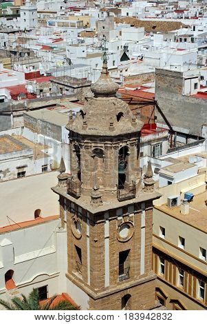 View of the Santiago church bell tower and city rooftops seen from the top of the Cathedral Cadiz Cadiz Province Andalusia Spain Western Europe.
