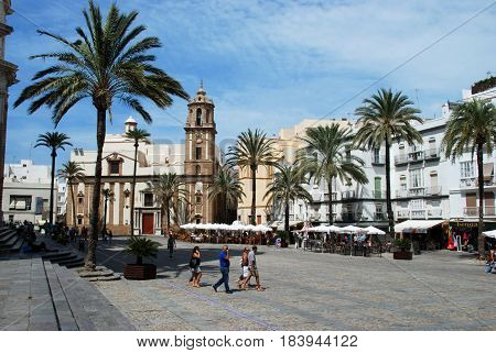 CADIZ, SPAIN - SEPTEMBER 8, 2008 - Santiago church in Cathedral Square with pavement cafes to the right hand side Cadiz Cadiz Province Andalusia Spain Western Europe, September 8, 2008.