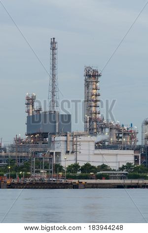 Oil refinery factory river front Industrail background