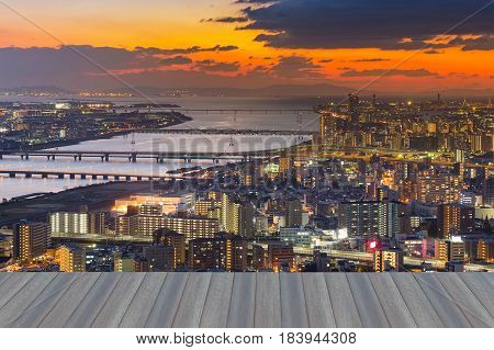 Opeing wooden floor Osaka city business aerial view with sunset sky background Japan
