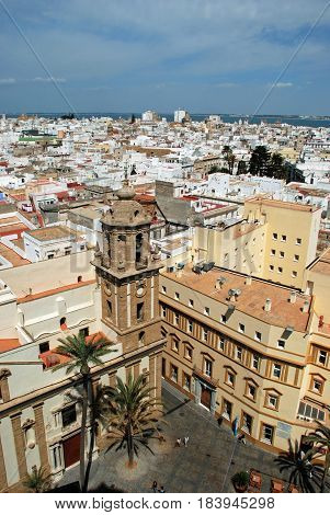 CADIZ, SPAIN - SEPTMEBER 8, 2008 - View of the Santiago church bell tower and city rooftops with the sea to the rear seen from the top of the Cathedral Cadiz Cadiz Province Andalusia Spain Western Europe, September 8, 2008.