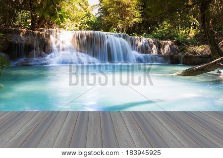 Opening wooden floor Blue stream natural deep forest waterfall nautral landscape background