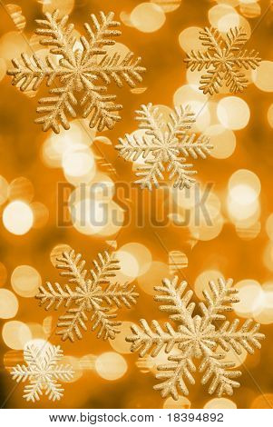 Ice stars and Christmas lights in yellow tone
