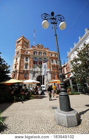 CADIZ, SPAIN - SPETMEBER 8, 2008 - Flower stalls and cafes in the Plaza de las Flores with the Post Office building to the rear Cadiz Cadiz Province Andalusia Spain Western Europe, September 8, 2008.