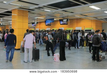 GUANGZHOU CHINA - NOVEMBER 13, 2016: Unidentified people queue to buy train tickets at Guangzhou South train station.