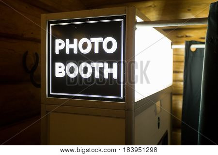 Sign at a wedding reception says photo booth.