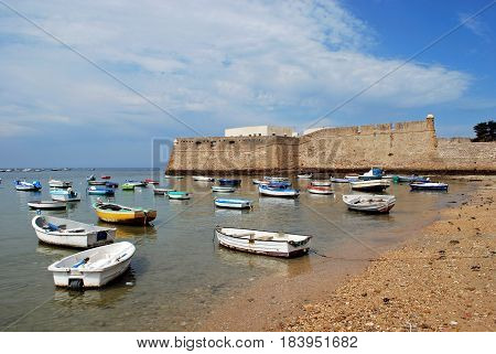 CADIZ, SPAIN - SEPTMEBER 8, 2008 - View of the castle with fishing boats in the foreground Cadiz Cadiz Province Andalusia Spain Western Europe, September 8, 2008.