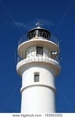 View of the top part of the whitewashed lighthouse tower Torrox Costa Malaga Province Andalusia Spain Western Europe.