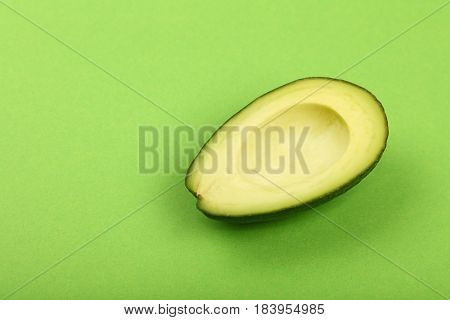 Fresh Ripe Avocado On Green Paper