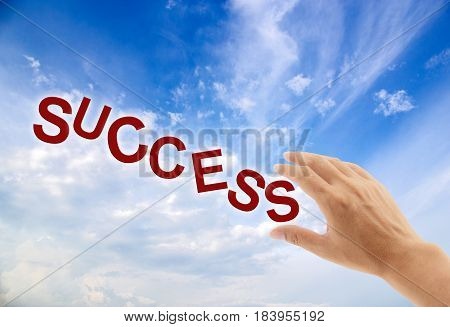 A Hand reaching up to grab success concept business