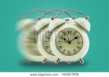 Vintage clock blurred - conceptual image of time running or passing away business concept