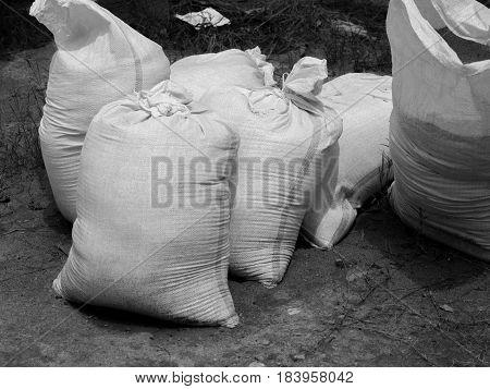 BLACK AND WHITE PHOTO OF SANDBAG OR SACK MADE OF HESSIAN (BURLAP) OR POLYPROPYLENE