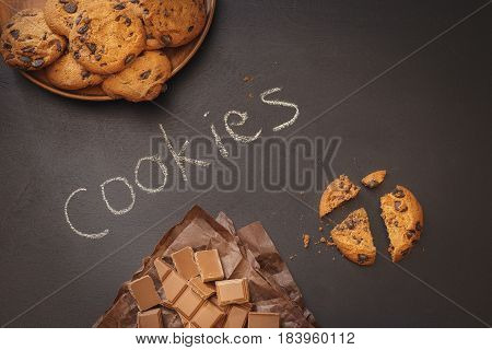 Chocolate chip cookies with word cookies written with chalk on blackboard