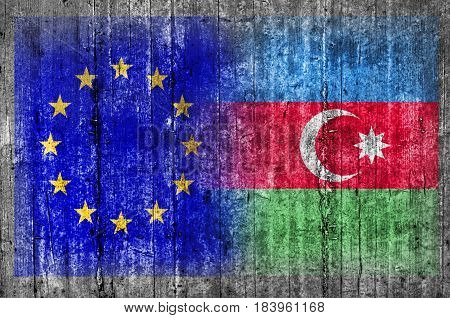 EU and Azerbaijan flag on concrete wall