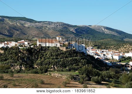 View of the church and town buildings El Burgo Malaga Province Andalusia Spain Western Europe.