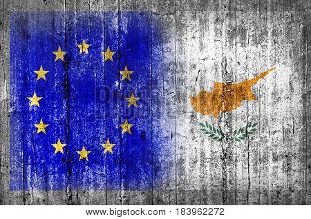 EU and Cyprus flag on concrete wall