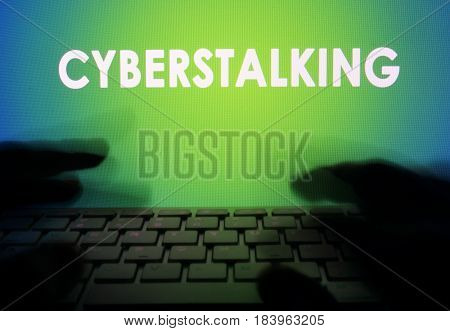 Cyberstalking on a monitor and a keyboard.