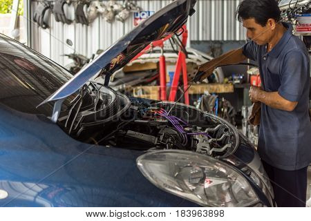 Checking A Car Engine For Repair At Car Garage