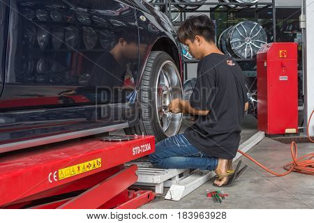 Checking A Car Suspension For Repair At Car Garage