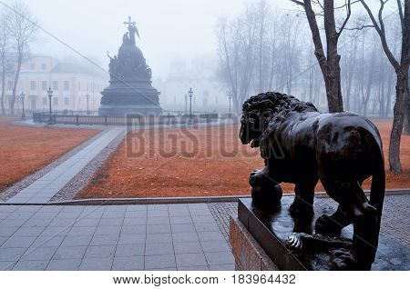 VELIKY NOVGOROD RUSSIA - NOVEMBER 6 2015. Architecture ensemble of Novgorod Kremlin - monument Millennium of Russia St Sophia Cathedral and lion sculpture. Autumn architecture foggy landscape