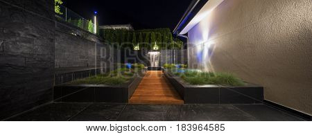 zen garden with a fountain at night, nobody