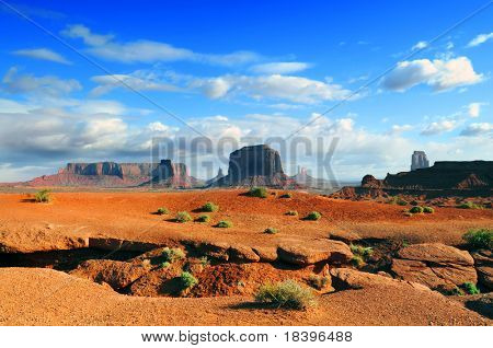 Monument Valley orange landscape with dramatic sky