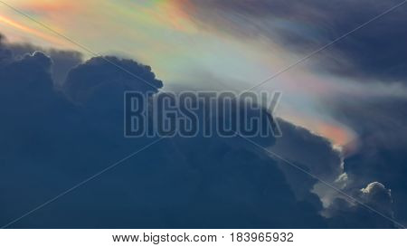 Beautiful colorful Iridescent cap clouds in the sky background