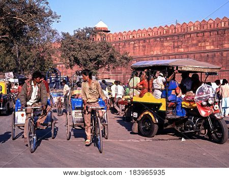 DELHI, INDIA - NOVEMBER 20, 1993 - View of the Red Fort with local people on bicycles and rickshaws in the foreground Delhi Delhi Union Territory India, November 20, 1993.