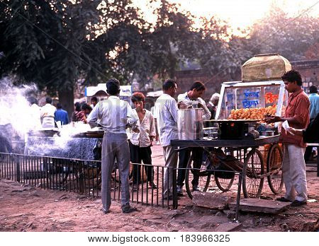 DELHI, INDIA - NOVEMBER 19, 1993 - Roadside food stalls near the Qutb Minar Delhi Delhi Union Territory India, November 19, 1993.