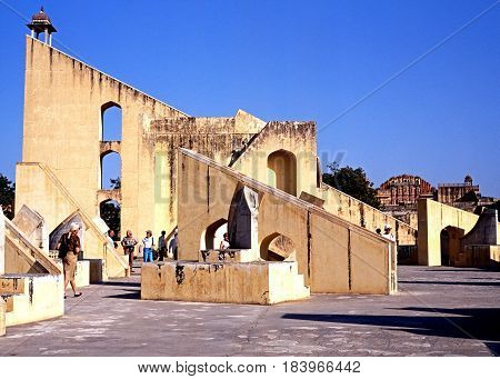 JAIPUR, INDIA - NOVEMBER 24, 1993 - View of the giant sundial known as the Samrat Yantra at Jantar Mantar Jai Singhs Observatory with people enjoying the sights Jaipur Rajasthan India, November 24, 1993.