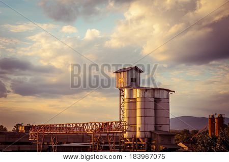 Plant on the background of sunset. Industrial landscape