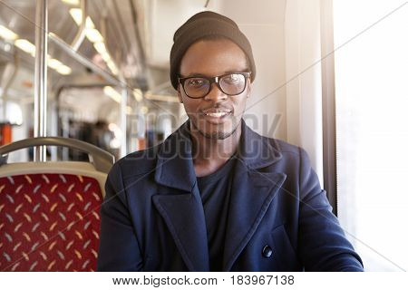 Young Happy And Handsome Dark-skinned Hipster Looking At Camera With Cheerful Smile, Dressed In Tren