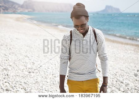 Outdoor Lifestyle Portrait Of Stylish Young Man With Backpack And Sunglasses Walking On Sunny Europe