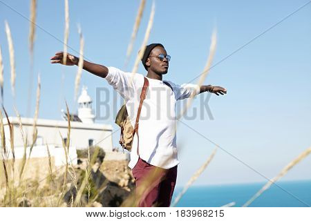 Free Happy Stylish Male Tourist Having Relaxed And Carefree Look While Standing On Edge Of Cliff, Sp