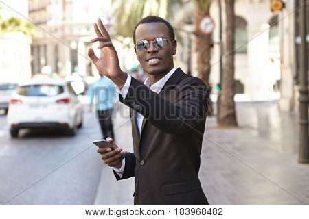 Friendly Looking Successful Young Afro American Entrepreneur In Elegant Black Suit And Eyewear Texti