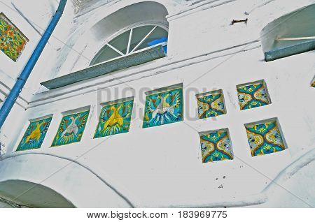 Architecture view of windows with bright old mosaic tiles in Nicholas Vyazhischsky stauropegic monastery Veliky Novgorod Russia. Architecture view with decorative architecture inlay details