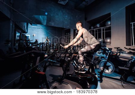 Young Man Riding An Exercise Bike