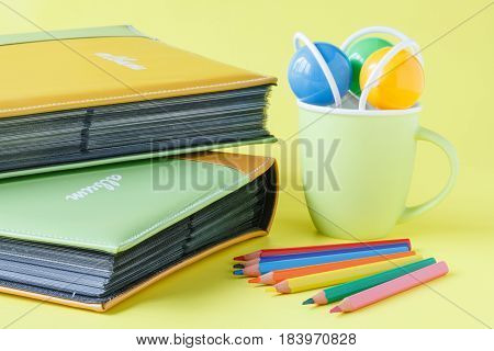Working on Photo Album on yellow background