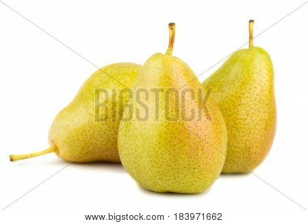 Three ripe yellow pears on white background