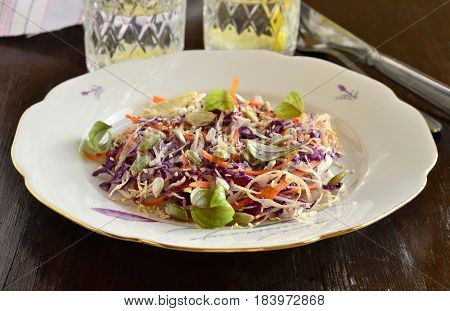 Salad with cabbage carrots and pumpkin sunflower sesame seeds. Cole Slaw