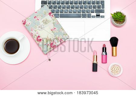 make up products on pink background. modern romance