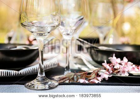 Wine glass on served festive table, closeup