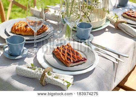 Plates with pie on served table in garden