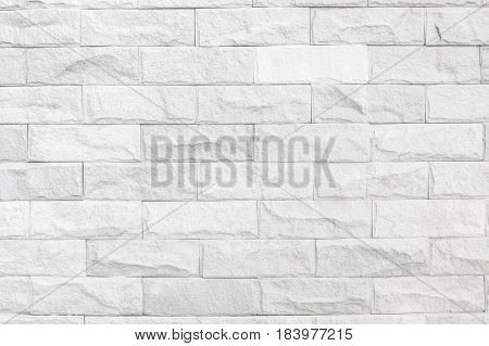 Gray colour stone wall background texture .