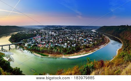 Panoramic view from above to famous ukraininan city Zaleshchiki in the Dnister river canyon at sunset. Ukraine, Ternopil region