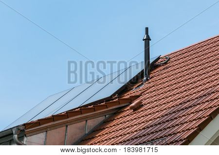 German House Orange Ceramic Tiles Solar Water Heater Blue Sky Sustainable Residential