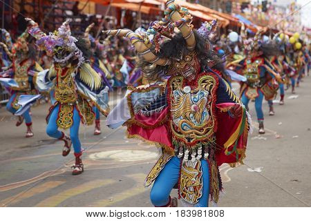 ORURO, BOLIVIA - FEBRUARY 26, 2017: Diablada dancers in ornate costumes parade through the mining city of Oruro on the Altiplano of Bolivia during the annual carnival.